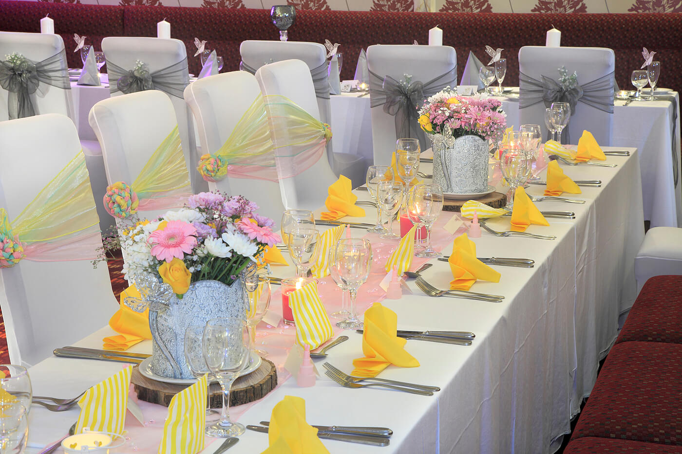 Wedding breakfast table setting, centering flowers